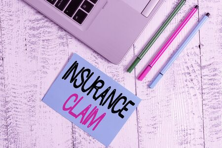 Handwriting text writing Insurance Claim. Conceptual photo coverage or compensation for a covered loss or policy event Trendy metallic laptop blank sticky pad three pens lying vintage table