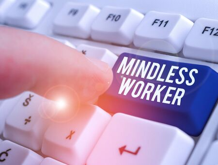 Text sign showing Mindless Worker. Business photo showcasing Having no intelligent purpose Showing little attention