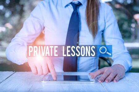 Writing note showing Private Lessons. Business concept for teaching which is usually paid privately by small groups Female business person sitting by table and holding mobile phone