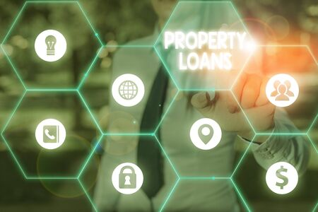 Handwriting text writing Property Loans. Conceptual photo a loan used to buy land or buildings and infrastructures Banque d'images