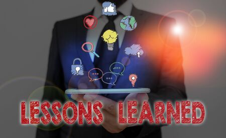 Conceptual hand writing showing Lessons Learned. Concept meaning the knowledge or understanding gained by experience
