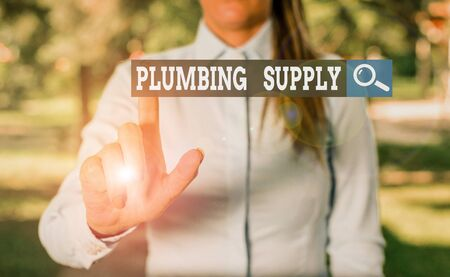 Writing note showing Plumbing Supply. Business concept for tubes or pipes connect plumbing fixtures and appliances Woman in a blue shirt pointing with her finger into empty space