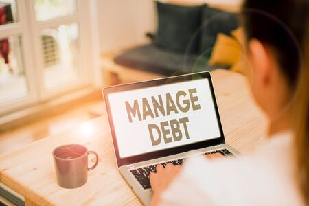 Writing note showing Manage Debt. Business concept for unofficial agreement with unsecured creditors for repayment 스톡 콘텐츠