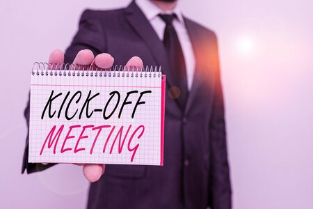 Text sign showing Kick Off Meeting. Business photo text first meeting with the project team and the client Male human wear formal work suit office look hold mathematics book use hand