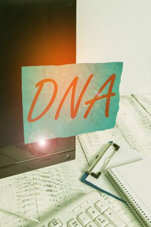 Text sign showing Dna. Business photo showcasing a selfreplicating material wpresent in nearly all living organisms Note paper taped to black computer screen near keyboard and stationary