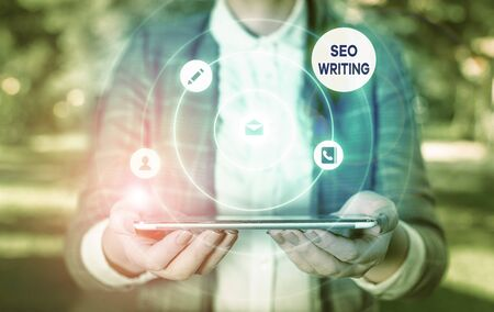 Writing note showing Seo Writing. Business concept for grabbing the attention of the search engines using specific word