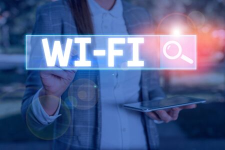 Conceptual hand writing showing Wi Fi. Concept meaning radio technologies commonly used for wireless local area networking Standard-Bild