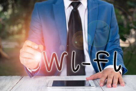 Handwriting text writing Wi Fi. Conceptual photo radio technologies commonly used for wireless local area networking Businessman holds pen and points into copy space