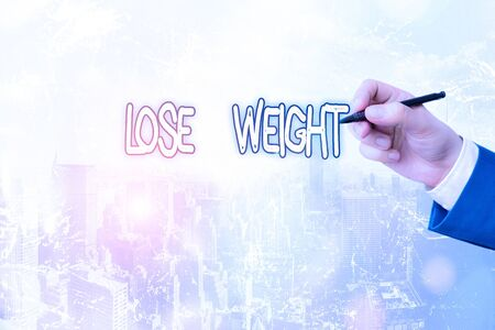 Conceptual hand writing showing Lose Weight. Concept meaning the fact of a demonstrating s is or an animal s is body weight becoming less Stock fotó