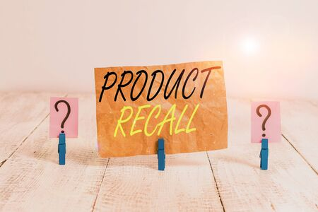 Word writing text Product Recall. Business photo showcasing process of retrieving potentially unsafe goods from consumers Scribbled and crumbling sheet with paper clips placed on the wooden table Stock Photo