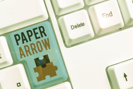 Writing note showing Paper Arrow. Business concept for Business infographic use to show direction or movement