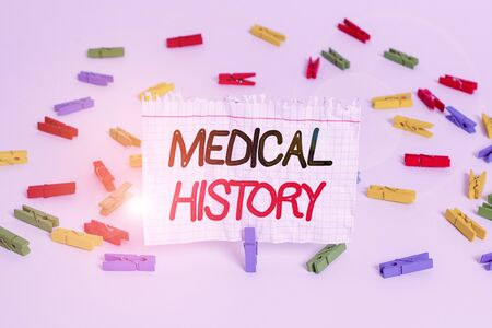 Conceptual hand writing showing Medical History. Concept meaning A record of information about a demonstrating s is health and medicare Colored clothespin papers empty reminder white floor office Stock fotó