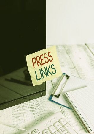 Writing note showing Press Links. Business concept for intended to manipulate a site s is ranking in Google search Note paper taped to black computer screen near keyboard and stationary