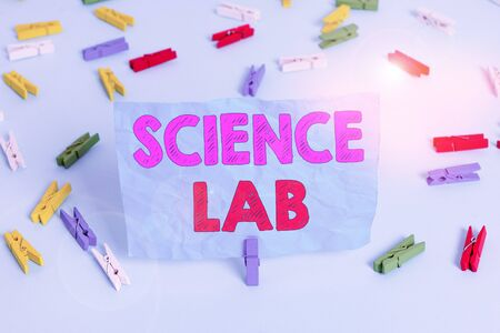 Word writing text Science Lab. Business photo showcasing special facility where experiments are done and with equipment Colored clothespin papers empty reminder blue floor background office pin 版權商用圖片