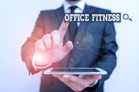 Handwriting text Office Fitness. Conceptual photo Encouraging fitness and balance lifestyle in the workplace Male human wear formal clothes present presentation use hi tech smartphone
