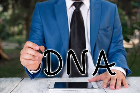 Handwriting text writing Dna. Conceptual photo a selfreplicating material wpresent in nearly all living organisms Businessman holds pen and points into copy space