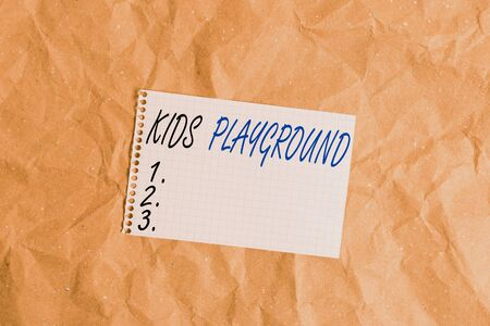 Text sign showing Kids Playground. Business photo showcasing piece of land designed for children to play in outside Papercraft craft paper desk square spiral notebook office study supplies