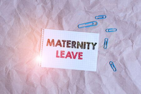 Conceptual hand writing showing Maternity Leave. Concept meaning the leave of absence for an expectant or new mother Papercraft desk square spiral notebook office study supplies