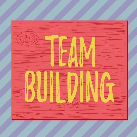 Handwriting text writing Team Building. Conceptual photo activities designed to increase motivation and cooperation Square rectangle unreal cartoon wood wooden nailed stuck on coloured wall