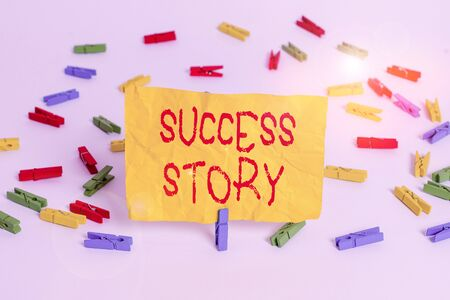 Word writing text Success Story. Business photo showcasing someone or something that has attain a goal Successful demonstrating Colored clothespin papers empty reminder white floor background office