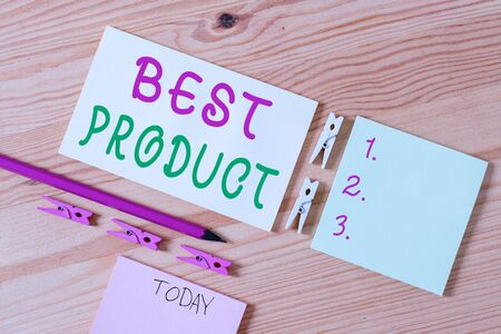 Writing note showing Best Product. Business concept for very popular and a large quantity of it has been sold Colored clothespin papers empty reminder wooden floor background office