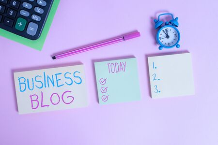 Handwriting text writing Business Blog. Conceptual photo Devoted to write about subject matter related to the company Multicolor notepads alarm clock calculator sheet marker colored background