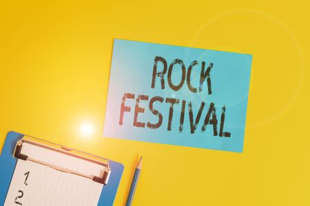 Conceptual hand writing showing Rock Festival. Concept meaning Largescale rock music concert featuring heavy metals genre Clipboard holding paper sheet square page pen colored background