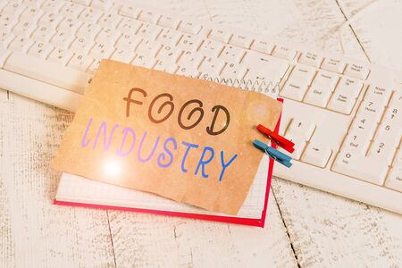 Handwriting text writing Food Industry. Conceptual photo Diverse businesses that supplies food to worlds population notebook paper reminder clothespin pinned sheet white keyboard light wooden 写真素材