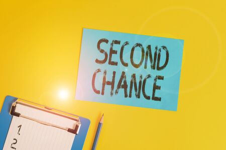 Conceptual hand writing showing Second Chance. Concept meaning opportunity to try something again after failing one time Clipboard holding paper sheet square page pen colored background