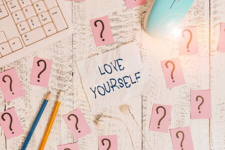 Text sign showing Love Yourself. Business photo text have selfrespect and the unconditional selfacceptance Writing tools, computer stuff and scribbled paper on top of wooden table Stok Fotoğraf