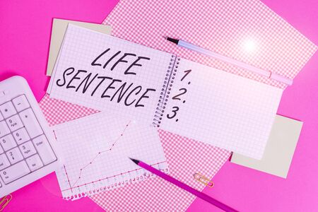 Conceptual hand writing showing Life Sentence. Concept meaning the punishment of being put in prison for a very long time Writing equipments and computer stuff placed on plain table