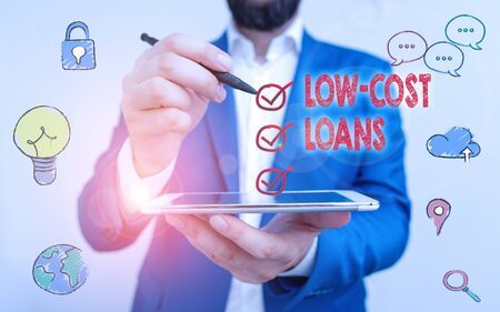 Writing note showing Low Cost Loans. Business concept for loan that has an interest rate below twelve percent Stock Photo