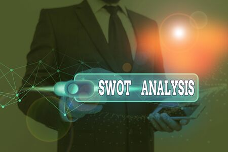 Handwriting text writing Swot Analysis. Conceptual photo framework used to evaluate a company competitive position