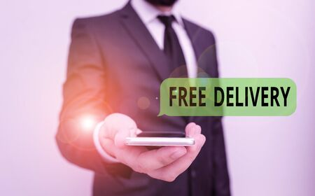 Word writing text Free Delivery. Business photo showcasing directly deliver to the recipient address without charge Male human wear formal work suit hold smart hi tech smartphone use one hand