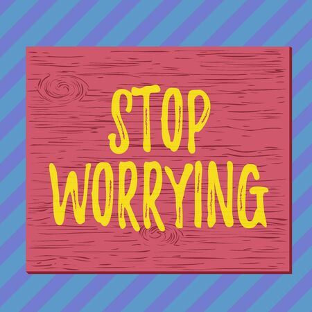 Handwriting text writing Stop Worrying. Conceptual photo stop thinking about something bad that happened in the past Square rectangle unreal cartoon wood wooden nailed stuck on coloured wall