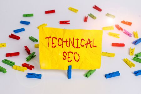 Word writing text Technical Seo. Business photo showcasing Optimization of website that doesn t involve the content part Colored clothespin papers empty reminder white floor background office