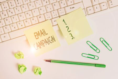Handwriting text writing Email Campaign. Conceptual photo advertisements are sent to a targeted list of recipients Square green note paper with pencil on the white background