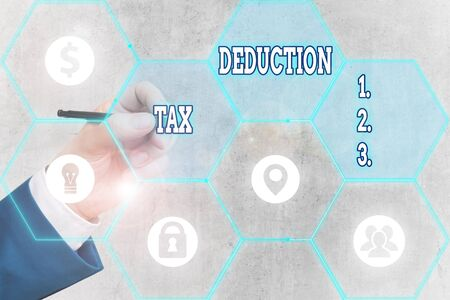 Conceptual hand writing showing Tax Deduction. Concept meaning amount subtracted from income before calculating tax owe