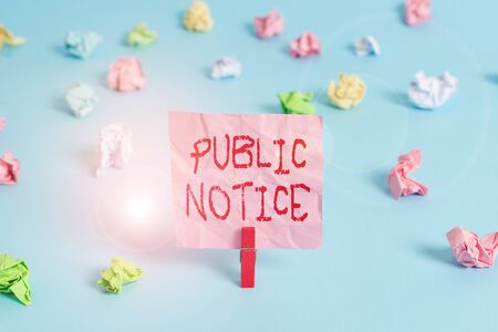 Writing note showing Public Notice. Business concept for Announcements widely disseminated through broadcast media Colored crumpled rectangle shaped reminder paper light blue background