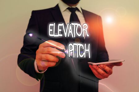 Conceptual hand writing showing Elevator Pitch. Concept meaning the elevator statement is a short description of an idea