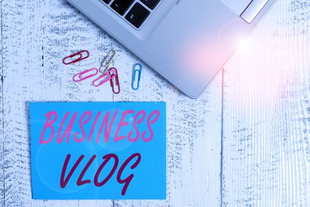 Writing note showing Business Vlog. Business concept for A video content about subject matter related to the company Trendy metallic laptop blank sticky note colored clips on vintage table