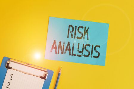 Conceptual hand writing showing Risk Analysis. Concept meaning review of the risks associated with a particular event Clipboard holding paper sheet square page pen colored background