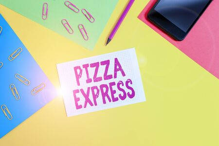 Handwriting text writing Pizza Express. Conceptual photo fast delivery of pizza at your doorstep Quick serving Paper sheets pencil clips smartphone squared notebook colored background Standard-Bild