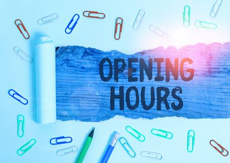 Writing note showing Opening Hours. Business concept for the time during which a business is open for customers Stock Photo