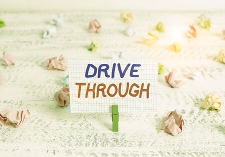 Conceptual hand writing showing Drive Through. Concept meaning place where you can get type of service by driving through it Green clothespin white wood background reminder office supply