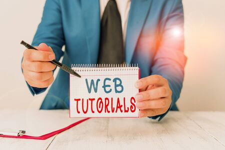 Text sign showing Web Tutorials. Business photo text Self study activity aimed to teach a specific learning outcome Man holds empty paper with copy space in front of him Copy Space