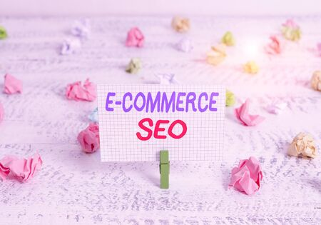Conceptual hand writing showing E Commerce Seo. Concept meaning making your online store more visible in the search engine Green clothespin white wood background reminder office supply