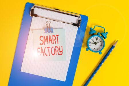 Text sign showing Smart Factory. Business photo text A highly digitized and connected production facility Clipboard paper sheet note binder pencil alarm clock colored background Stock Photo