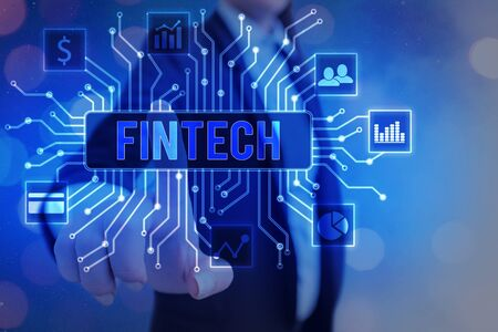 Writing note showing Fintech. Business concept for Financial technology concept. Enabling through Tech and Fin FinTech to build system and concepts without banks.