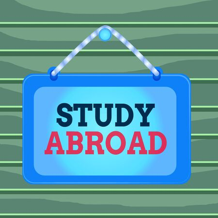 Conceptual hand writing showing Study Abroad. Concept meaning live in a foreign country and attend a foreign university Board fixed nail frame colored background rectangle panel Foto de archivo
